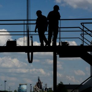2 construction workers at height