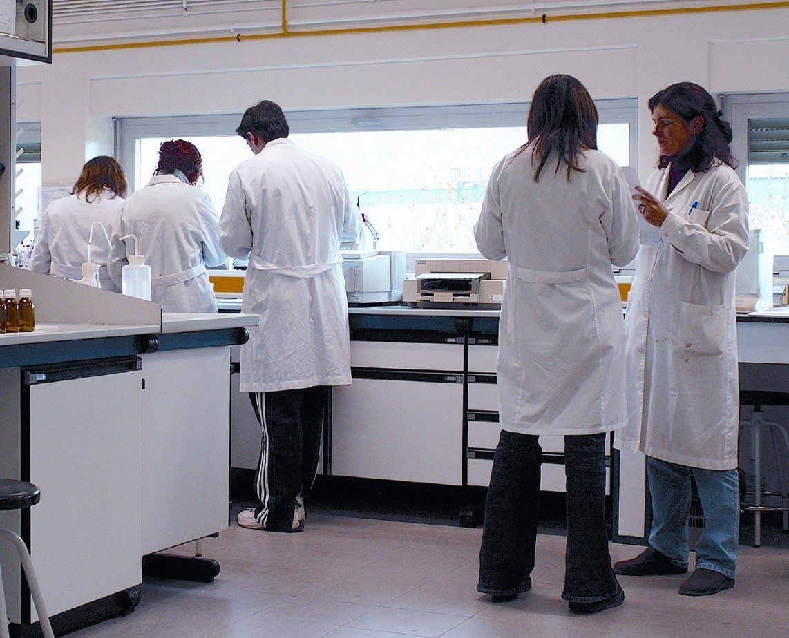 researchers talking about lab results